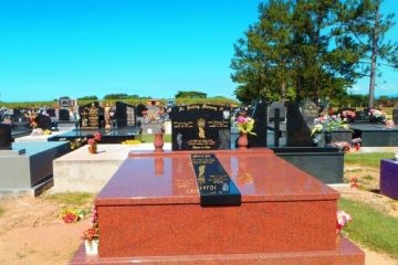 African-Red-double-granite-memorial-black-headstone-center-ledger-500x500