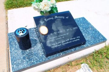 Black-granite-lay-down-headstone-blue-pearl-base-1x-vase