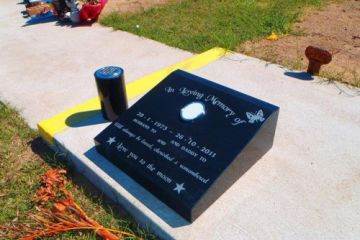 Solid-black-lay-down-headstone-with-natural-inscription-500x